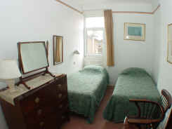 Bedroom of 2nd floor self catering flat with twin beds, also can be made up as double
